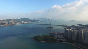 An aerial view fly over Tsing Ma Bridge under sunny day stock video