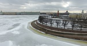 Aerial view. Flying along the river Neva in winter overcast cold weather. Bridge over the river Petersburg. The height of the bird stock photo