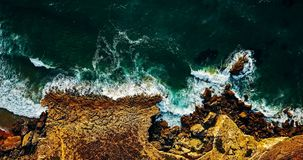 Aerial View From Flying Drone Of Ocean Waves Crushing On Rocky Beach Royalty Free Stock Image
