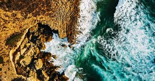 Aerial View From Flying Drone Of Ocean Waves Crushing On Rocky Beach Stock Photos