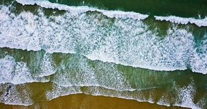 Aerial View From Flying Drone Of Ocean Waves Crushing On Beach Stock Photo