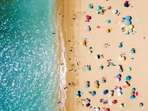 Aerial View From Flying Drone Of People Crowd Relaxing On Beach royalty free stock photography