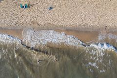 Aerial View From Flying Drone Of People Crowd Relaxing On Beach stock image