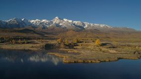 Aerial. Flying over the beautiful lake near mountains. Panorama. Autumn. Aerial View. Flying over the beautiful lake near mountains. Aerial camera shot stock video