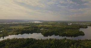 Aerial View. Flying over the beautiful lake. Sunny Day. Aerial camera shot. Aerial Drone footage, flying forward over a secluded lakes surrounded by dense forest stock video
