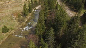 Aerial View. Flying over the beautiful mountain River and forest. 4k stock footage
