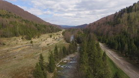 Aerial View. Flying over the beautiful mountain River and forest stock video