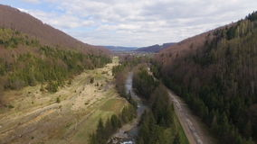 Aerial View. Flying over the beautiful mountain River and forest. 4k stock video footage