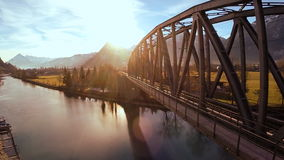 Aerial view flying over bridge landscape panorama sunset. Video of aerial view flying over bridge landscape panorama sunset stock footage
