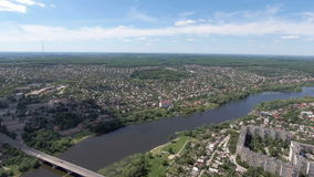 Aerial View. Flying over the city and bridge over the river stock footage