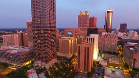 Aerial view flying over downtown Atlanta at dusk. Atlanta, Georgia, camera moves rising up. stock video footage