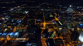 Aerial view flying over downtown Atlanta at night. freeway traffic headlights. Georgia USA. left motion camera stock video
