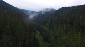 Aerial View. Flying over the high mountains in beautiful clouds . Aerial camera shot. Air clouds. Fog. Steam. stock video footage