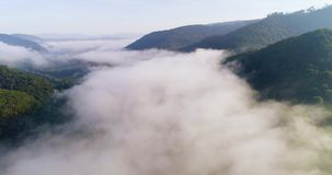 Aerial View. Flying over the high mountains in beautiful clouds . Aerial camera shot. Air clouds. stock video footage