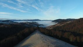 Aerial View. Flying over the high mountains in beautiful clouds . Aerial camera shot stock footage