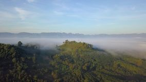 Aerial View, Flying over the mountains and trees with beautiful clouds and sky in sunrise. Landscape nature with aerial camera shot,Kanchanaburi Thailand stock video