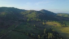 Aerial View, Flying over the mountains and trees with beautiful clouds and sky in sunrise. Landscape nature with aerial camera shot,Tak Thailand stock video