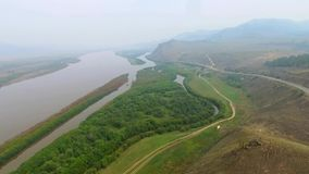 An aerial view flying over the river in the fog, Russian Buryatia stock footage