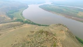 An aerial view flying over the river in the fog, Russian Buryatia stock video