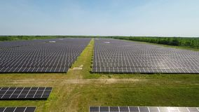 Aerial View. Flying over the solar power plant with sun. Solar panels and sun. Aerial drone shot. stock video footage