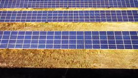 Aerial View. Flying over the solar power plant with sun. Solar panels and sun. Aerial drone shot stock footage