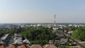 Aerial view above the houses with small city scene. Aerial view. Flying up above the houses with small city scene in Trang Thailand stock footage