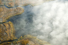 Aerial view of fog in autumn over islands and hills north of Portland Maine Stock Image