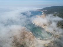 Aerial View of Fog and Northern California Coastline. Fog drifts across the beautiful northern California coastline in Sonoma. Thick fog, generated by a layer of stock images