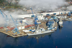 Aerial view of fog over Bath Iron Works and Kennebec River in Maine.  Bath Iron Works is a leader in surface combatant design and. Construction with a $27 Royalty Free Stock Photography