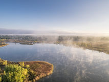 Aerial view of a foggy lake Royalty Free Stock Images