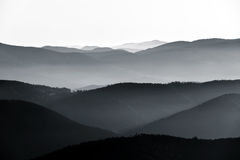Aerial view of foggy mountains relief Stock Photography