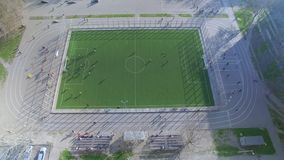 Aerial view of football field with amateur football players. Aerial topside down view of football field with amateur football players stock video
