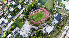 Aerial view of football stadium in town, Banska Bystrica, Slovak. Aerial view of football stadium, apartment buildings and streets in town, Banska Bystrica Royalty Free Stock Images