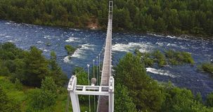 Aerial View of Footbridge over the Rough River. Aerial View of Footbridge over the Rough Niva River in the Kandalaksha Town in Russia Stock Photography