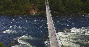 Aerial View of Footbridge over the Rough River. Aerial View of Footbridge over the Rough Niva River in the Kandalaksha Town in Russia Royalty Free Stock Images