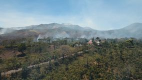 Aerial view Forest fire. Jawa island, Indonesia. Aerial view forest fire on the slopes of hills and mountains. Forest and tropical jungle deforestation for Stock Photo