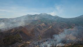 Aerial view Forest fire. Jawa island, Indonesia. Aerial view forest fire on the slopes of hills and mountains. Forest and tropical jungle deforestation for Stock Photography