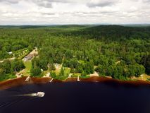 Aerial view of forest lake with ponton Royalty Free Stock Photography