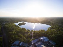 Aerial view of forest lake near traine station and telecommunications tower stock photos