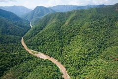 Aerial view forest of Thailand, Teak forest and river in rainy s. Eason. Thai-Myanmar Border, Mae Hong Son Province. Wide angle. Soft sunlight Royalty Free Stock Image