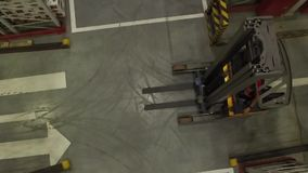 Aerial View of Fork Lift Truck. Driving in storage warehouse. Logistic, retail industry concept stock video footage