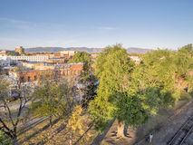 Aerial view of Fort Collins. Downtown in sunrise light, shot from a low flying drone Stock Photo