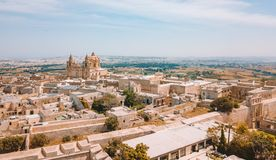 Aerial view of the fortified capital city of Malta. Silent City, Mdina or L-Imdina, skyline against blue Spring skies with huge walls, cathedral domes and Royalty Free Stock Image