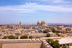 Aerial view of the fortified capital city of Malta. Silent City, Mdina or L-Imdina, skyline against blue Spring skies with huge walls, cathedral domes and Royalty Free Stock Photography