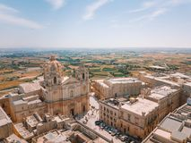 Aerial view of the fortified capital city of Malta. Silent City, Mdina or L-Imdina, skyline against blue Spring skies with huge walls, cathedral domes and Stock Images