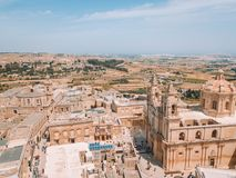 Aerial view of the fortified capital city of Malta. Silent City, Mdina or L-Imdina, skyline against blue Spring skies with huge walls, cathedral domes and Royalty Free Stock Images