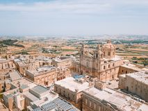 Aerial view of the fortified capital city of Malta. Silent City, Mdina or L-Imdina, skyline against blue Spring skies with huge walls, cathedral domes and Stock Image