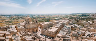 Aerial view of the fortified capital city of Malta. Silent City, Mdina or L-Imdina, skyline against blue Spring skies with huge walls, cathedral domes and Royalty Free Stock Photo
