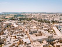 Aerial view of the fortified capital city of Malta. Silent City, Mdina or L-Imdina, skyline against blue Spring skies with huge walls, cathedral domes and Royalty Free Stock Photos