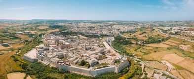 Aerial view of the fortified capital city of Malta. Silent City, Mdina or L-Imdina, skyline against blue Spring skies with huge walls, cathedral domes and Stock Photo